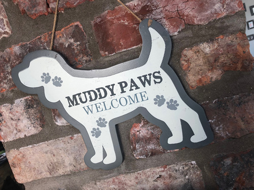 The Cowshed Muddy Paws Logo